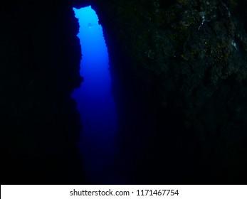 cave diving underwater scuba divers exploring cave dive