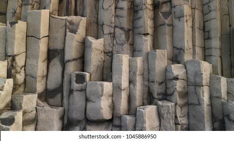 HÁLSANEFSHELLIR CAVE, ICELAND - OCTOBER 25, 2017:  Basalt Columns found in Iceland. These rocks are shaped like pillars, weirdly enough.