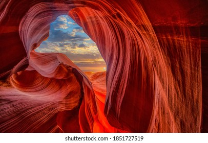 Cave light in abstract naturally red sandstone rock mountains
