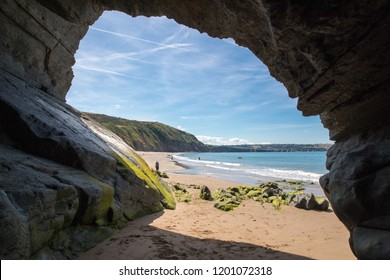Cave on the sandy beach in Penbryn, Cardigan Bay, Wales. Taken on a sunny day when the beach was empty.