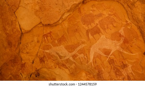 Cave paintings and petroglyphs in Bichagara Cave camel, cow in Ennedi, Chad