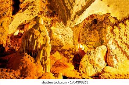 Cave rock walls scene view. Magic light into cave. Cave rock walls in magic light