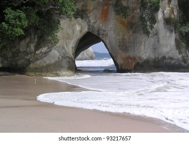 Cave that goes right trough mountain on the beach.