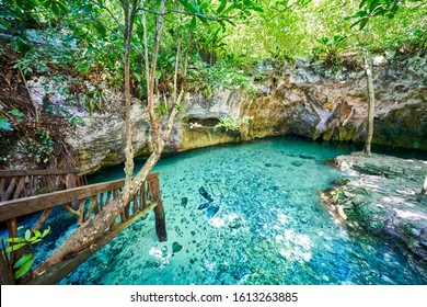 The cave with turquoise waters on the Gran Cenote in riviera maya - quintana roo, Mexico