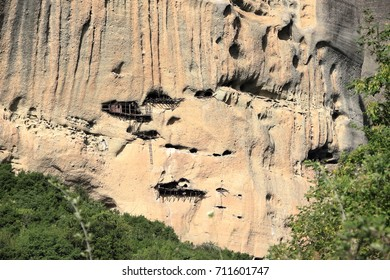 Caves in Rock Face - Askitiria or extreme hermitages above St. Antony's hermitage. Meteora , central Greece.