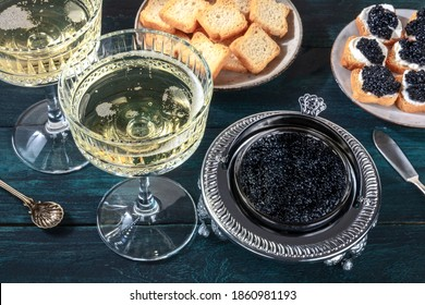 Caviar and champagne, vintage style, with bread and toasts