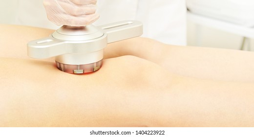 Cavitation cosmetology woman procedure. Lipo ultrasonic machine. Body anti cellulite treatment. Ultrasound radio girl therapy.