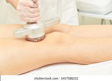 Cavitation cosmetology woman procedure. Lipo ultrasonic machine. Body anti cellulite treatment. Ultrasound radio girl therapy.