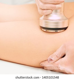 Cavitation machine therapy. Woman body lipo treatment. Ultrasound salon device. Radio frequency cosmetology procedure.