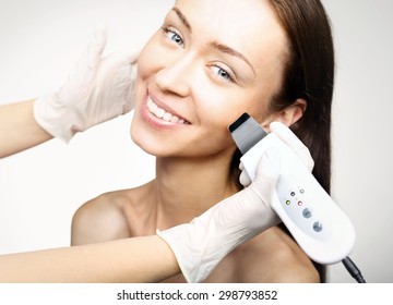Cavitation peeling, beauty treatment.The woman's face during a facial at a beauty salon