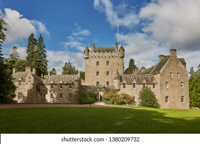 CAWDOR, NAIRN, SCOTLAND, UK - AUGUST 07, 2017: Front of Cawdor Castle with turret and drawbridge with bell and Stags Head Buckel Be Mindfull emblem.