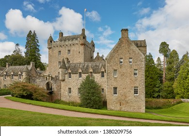 CAWDOR, NAIRN, SCOTLAND, UK - AUGUST 07, 2017: Front of Cawdor Castle with turret and drawbridge with bell and Stags Head Buckel Be Mindfull emblem. The castle has been known from Shakespeare's traged