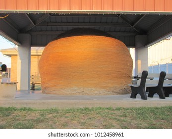 Cawker City, KS / USA - September 28, 2015: The world's largest ball of sisal twine sits proudly under a protective canopy in Cawker City, KS.