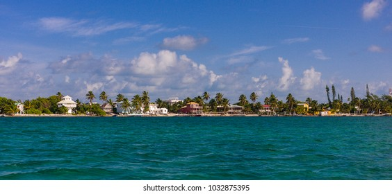 CAYE CAULKER, BELIZE - AUGUST 7, 2008: Waterfront showing hotels, houses, and palm trees.