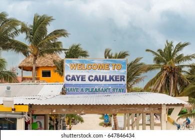 Caye Caulker, Belize - December 24, 2016: Welcome sign at the wooden pier dock in Caye Caulker. It is a small island near Ambergris Caye, Belize.