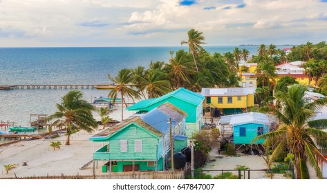Caye Caulker, Belize - December 24, 2016: Aerial view at wooden pier dock  and picturesque, relaxing ocean view at Caye Caulker Belize Caribbean.