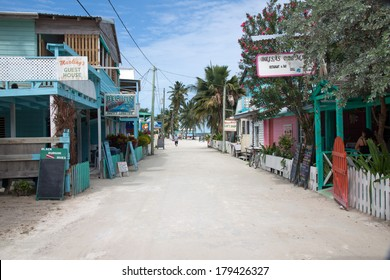 """CAYE CAULKER, BELIZE - FEBRUARY 16, 2013: People relaxing and drinking on the sunset in the """"split of Caye Caulker, a small island located approximately 20 miles from Belize City, Belize"""