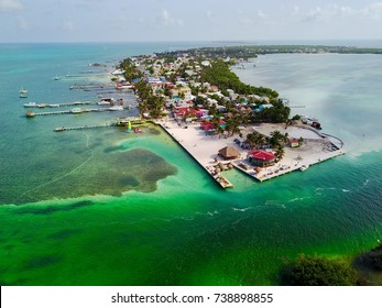 Caye Caulker Island, Belize A small island in the Caribbean Sea off the coast of Belize. It is surrounded by crystal clear blue ocean and near the second biggest barrier reef in the world.