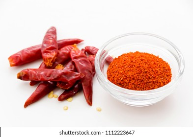 Cayenne pepper powder in Stacking bowl with Capsicum annuum isolated white background