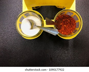 Cayenne pepper and suger on the table