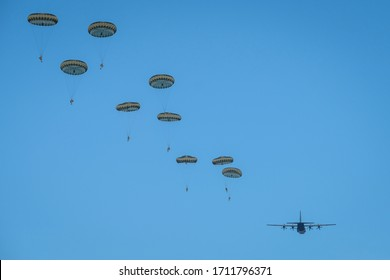 CAYLUS, FRANCE - NOVEMBRE 14: French, british and american paratroopers jumping together from a plane in south of France for the training of the Falcon Amarante mission