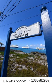 CAYMAN ISLANDS - DEC 30, 2014: Sign of Shipbuilding on Maritime Heritage Trail with Cruise ships on the seas at George Town, Grand Cayman, Cayman Islands.