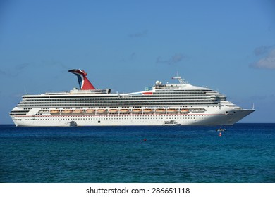 CAYMAN ISLANDS - DEC 30, 2014: Carnival Cruise ship Victory anchored offshore in George Town, Cayman Islands.