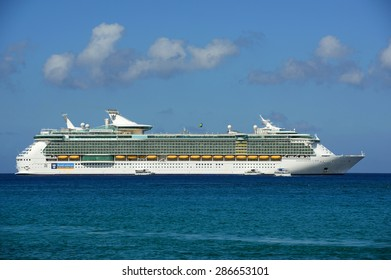 CAYMAN ISLANDS - DEC 30, 2014: Royal Caribbean International Cruise ship Independence of the Seas anchor offshore in George Town, Cayman Islands.