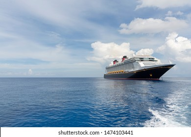 Cayman Islands - September 05, 2017: Cruise ship Disney Fantasy by Disney Cruise Line off the coast of Cayman Islands as tender boats takes guests ashore