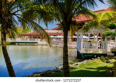 Cayo Coco island, Cuba, June 26, 2016, amazing gorgeous, inviting landscape view from tropical garden on Memories Caribe resort grounds near the lobby outdoor terrace on sunny summer day