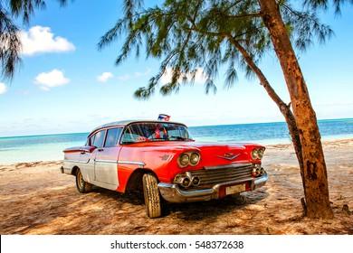 Cayo Jutias, Cuba - December 14, 2016: American classic car on the beach Cayo Jutias, Province Pinar del Rio, Cuba