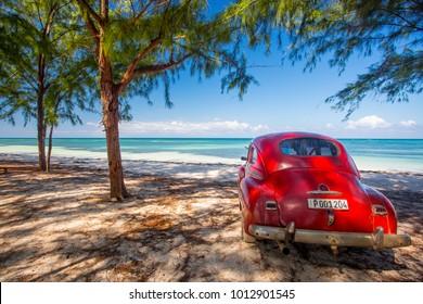 Cayo Jutias, Cuba - December 2, 2017: Classic car on a beach in Cuba