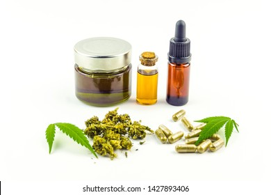 CBD cannabidiol oil glass bottles, pills flower buds and Cannabis leafs isolated on white