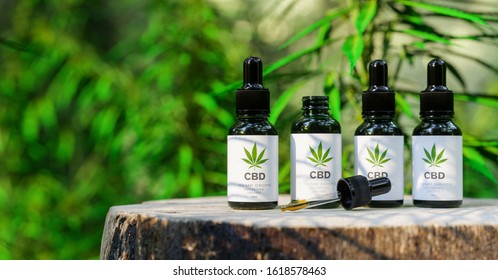 CBD cannabis OIL. Cannabis oil in pipette, hemp product. Concept of herbal alternative medicine, cbd oil, pharmaceutical industry