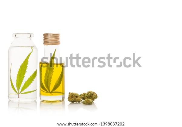 CBD marijuana oil and extract with marijuana buds, isolated on white background.