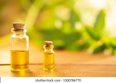 CBD oil background with two vials of oil and marijuana leaves