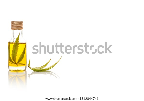 CBD oil. Medical marijuana oil extract in glass jar isolated on white background with copy space.