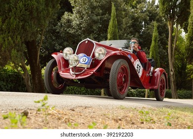 C.BERARDENGO (SI), ITALY - SEPTEMBER 19: A red 1934 Fiat 508 Balilla driven by Vesco - Guerini takes part in the GP Nuvolari classic car race on September 19, 2015 in C.Berardengo. They won the race.