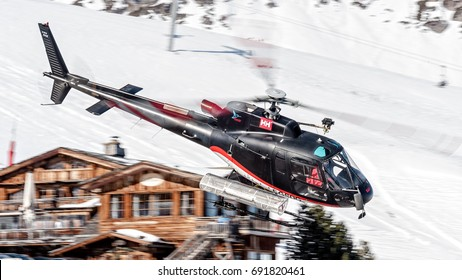 CCOURCHEVEL ALTIPORT - FEBRUARY 25, 2017: Airbus Helicopters H125 - Eurocopter AS350 B3E Ecureuil in flight over Altiport, France. Used to bring people over the Alps Mountains during winter holidays.