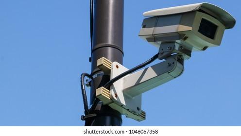 CCTV against blue sky background