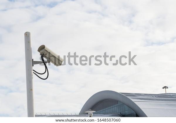 cctv-camera-against-cloudy-sky-600w-1648