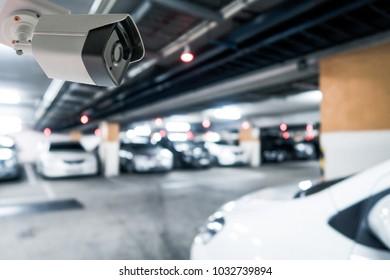 CCTV camera Blur image and Boken Night Car Parking