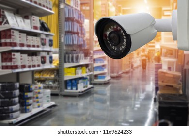 CCTV camera with Blurred shelf of warehouse background.