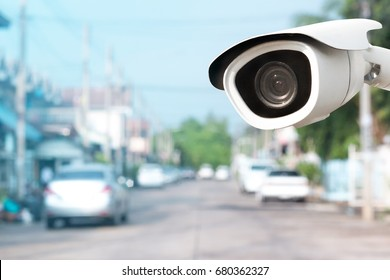 CCTV Camera with house background.