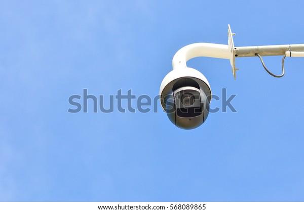 CCTV camera isolated on blue background.