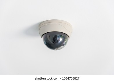 CCTV camera on white ceiling background.