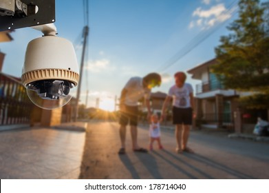 CCTV Camera Operating with family in background of village