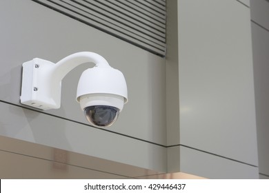 CCTV Camera Operating inside a airport or train station or department store,selective focus