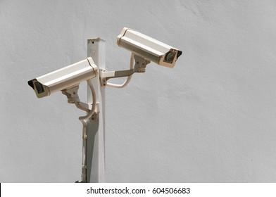cctv camera security on pole and cement background