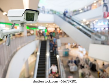 CCTV camera in shopping mall. security camera shopping mall on blurry background